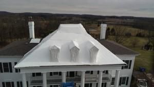 Mansion Roof Covered After Fire Damage
