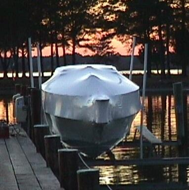 Wrapped Boat on Lift at Sunset